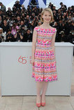 Mia Wasikowska chose a colourful pink-injected frock for the Lawless photocall.