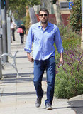 Ben Affleck looked casual in a blue shirt and sneakers.