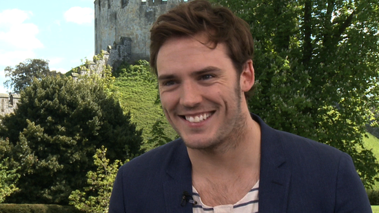 Video: Sam Claflin Talks Love Triangles and Horseback-Riding Mishaps on the SWATH Set