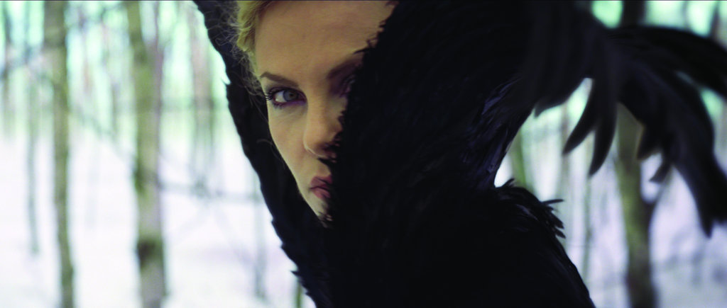 Ravenna's feathered, hooded cloak is positively frightening. Photo courtesy of Universal Pictures
