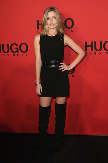 Georgia May knows how to do all black sexy. Just throw on a black sleeveless minidress with black over-the-knee boots and cinch your waist with a wide black cutout belt. Add a few silver bangles and rings to mimic the model's monochromatic look.  6940245
