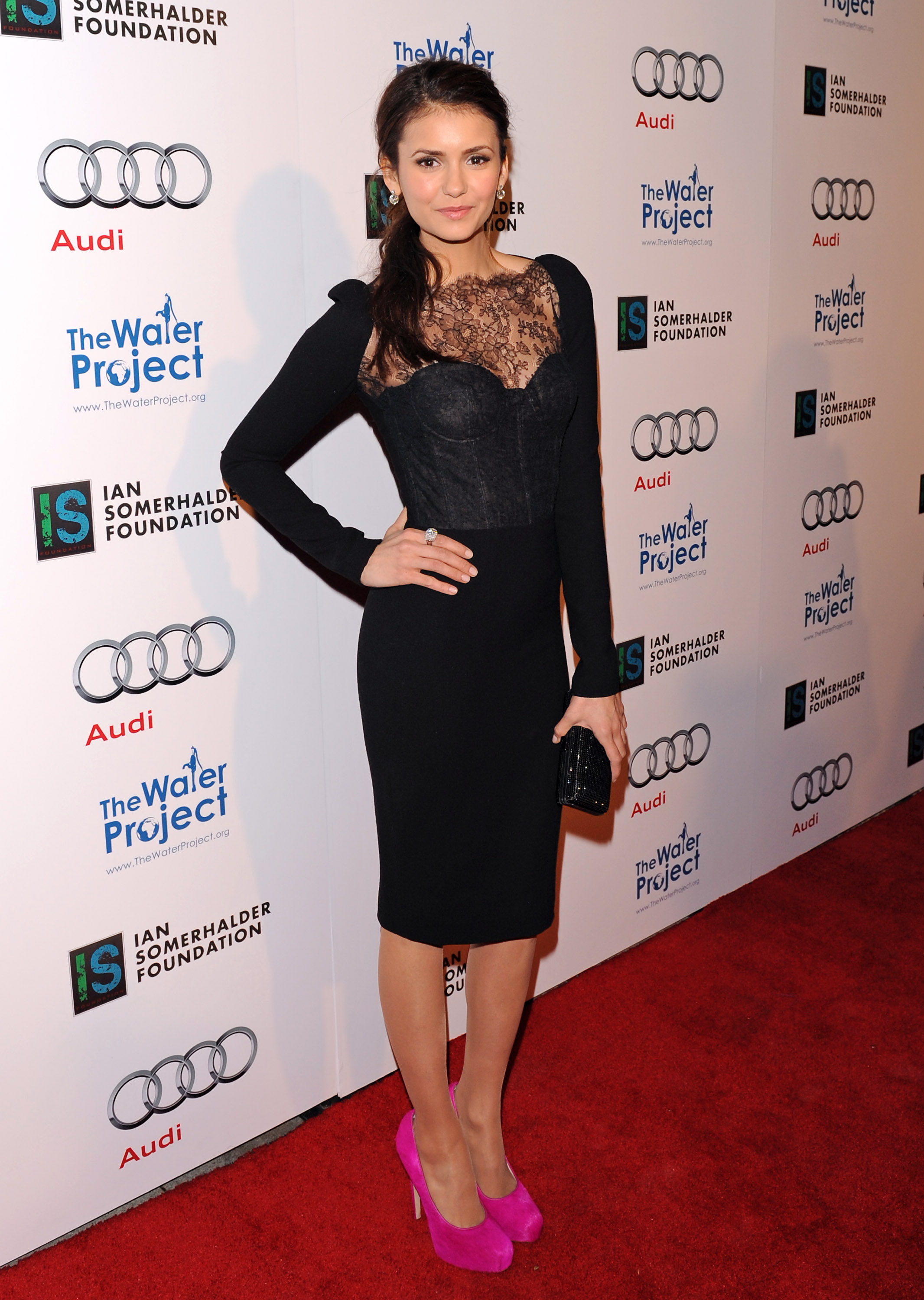 Once again, Nina accented her lace-infused black Monique Lhuillier sheath at The Ripple Effect charity event in 2012 with a bold pair of pink pumps.