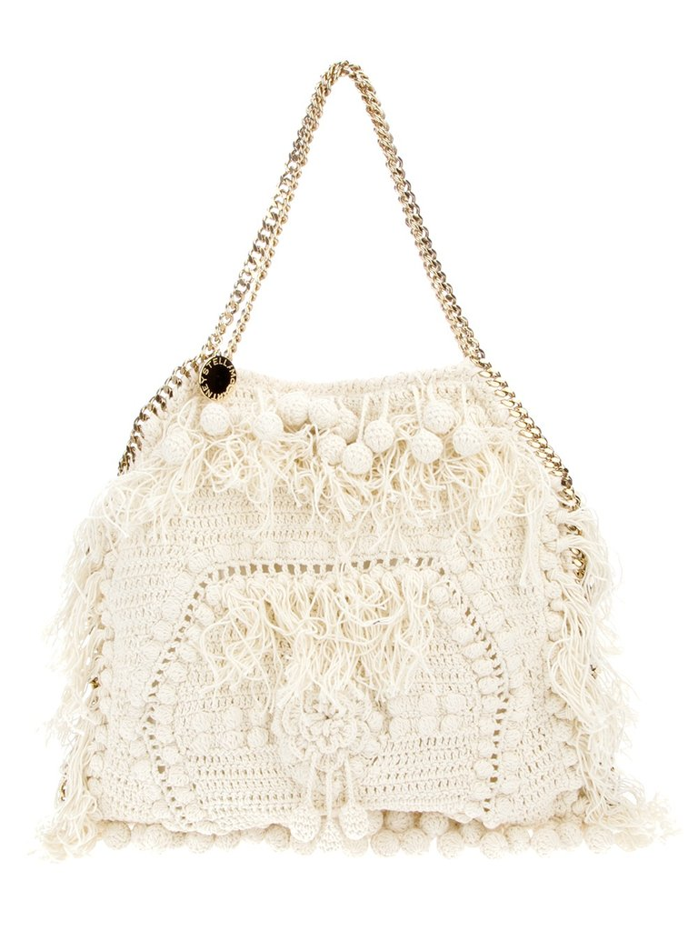 Stella McCartney's crochet Falabella tote has gained traction as the ultimate bohemian-chic carryall, and for good reason: it goes with everything, and gives a beachy vibe to any ensemble. Stella McCartney Falabella Crochet Tote ($2,289)