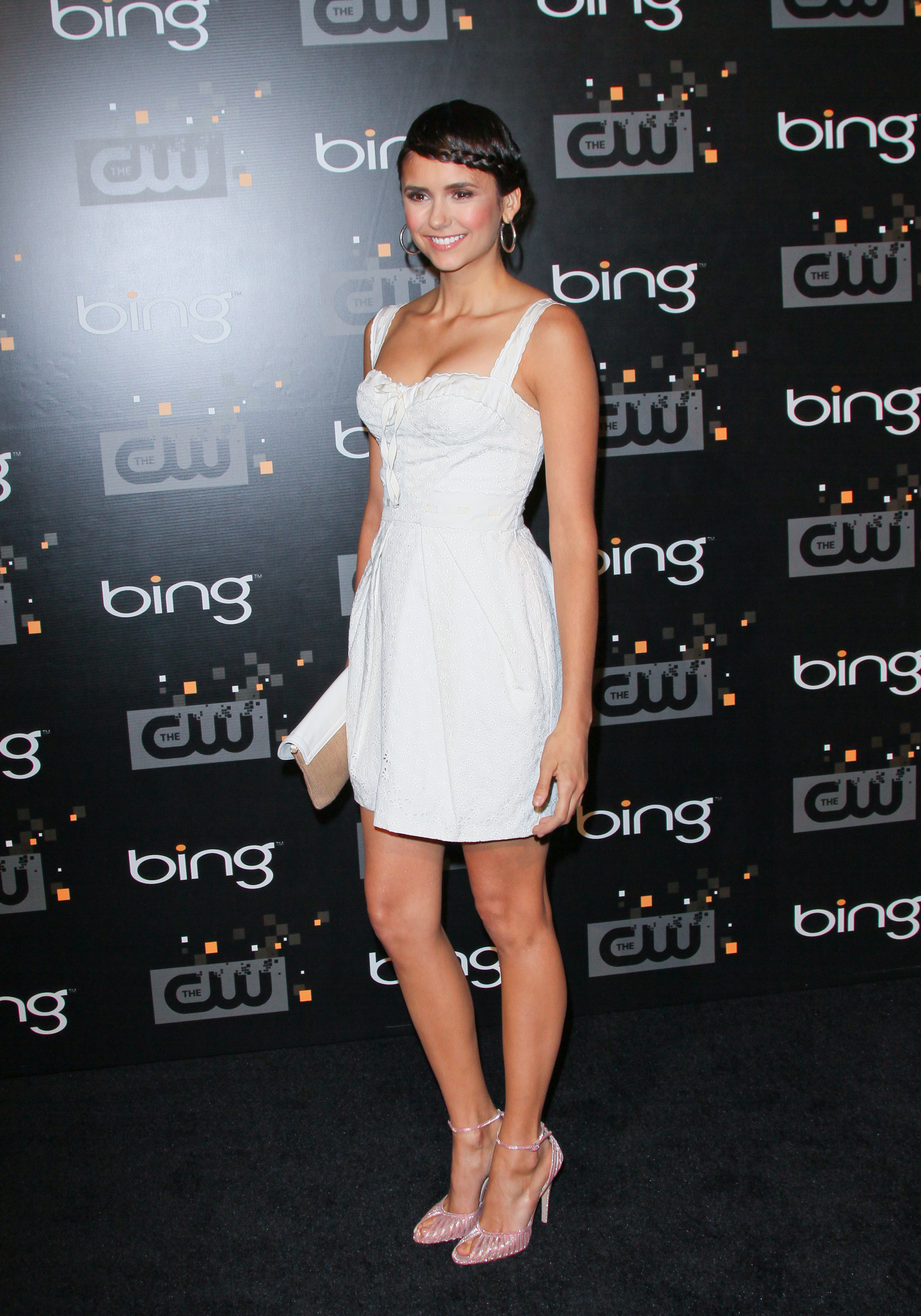 She kept her LWD sweet by adding light pink heels and a front braid to the mix at the Vampire Diaries premiere party in 2011.