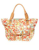 Inject a dose of seasonal floral into your look — wherever you may go.  Asos Floral Print Pocket Shopper Bag ($61)