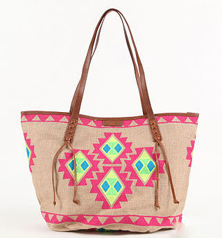 A tribal-inspired print in bold neoprene hues is sure to liven up your look.  Billabong Going Places Bag ($49)