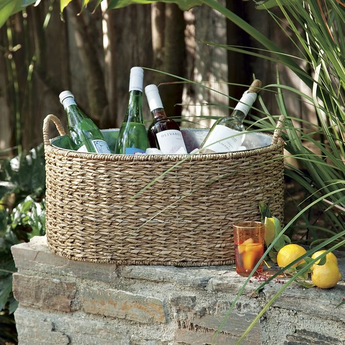 This Woven Drink Bucket ($69) has a galvanized steel insert and would be a great textural addition to an outdoor dining space.