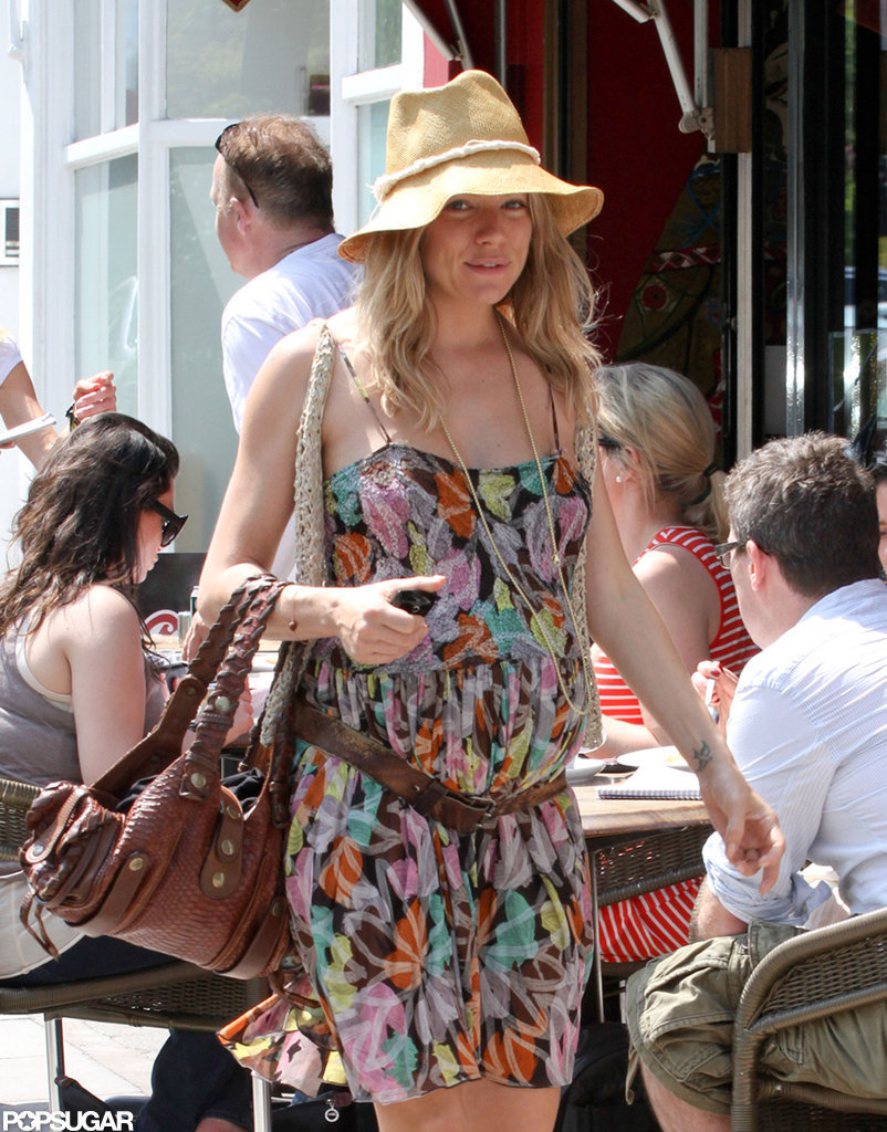 Sienna Miller looked cute in a colorful dress while walking through a London neighborhood.