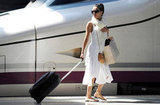 Eva Longoria was loaded down with bags while hopping a train in Spain.