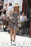 Sienna Miller walked through London wearing cute boots.