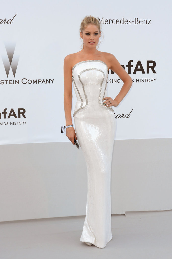 Doutzen Kroes stepped out in a fitted corset-style white Versace column dress for the amfAR Gala in Cannes.