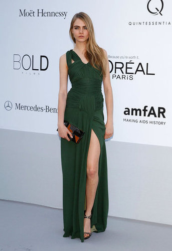 From the front, Cara struck a pose in this sleek and sexy green gown.