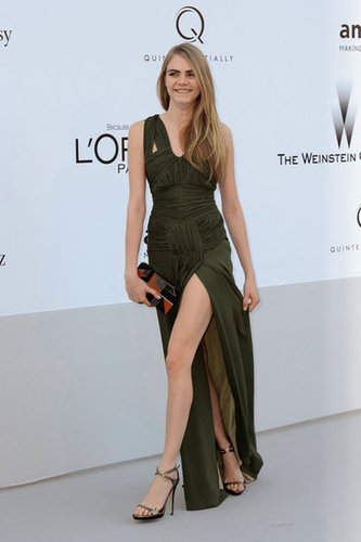 Cara Delevingne is the latest stunner to take on the thigh-high slit trend, this time in a sage green number.