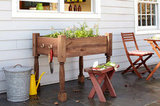 Get your kitchen garden going with this raised herb garden planter. Source: This Old House