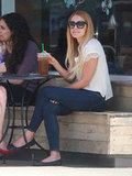 Lauren Conrad sat at a table outside at Starbucks in LA.