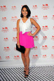 Olivia Munn made a bold statement in her neon pink Naven miniskirt. Her tie-front white Fifteen Twenty blouse, black ankle-strap sandals, and black clutch kept the skirt the center of attention.