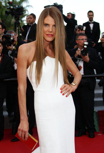 Anna Dello Russo's white gown fit like a glove, and she complemented the dress with a sleek modern clutch.