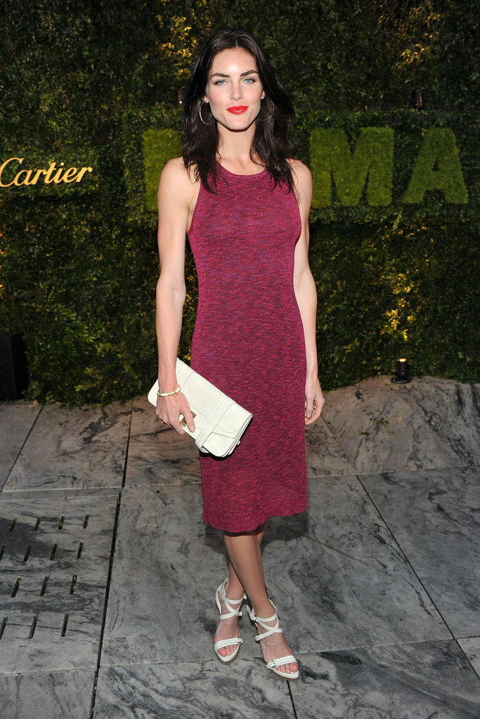 Hilary Rhoda attended the MoMA's fete in a body-con knit dress and perfectly chic white add-ons.