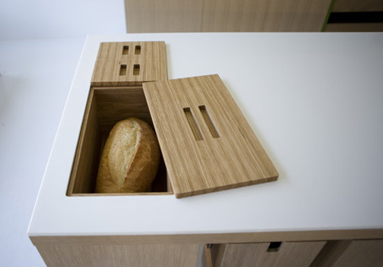We dig the creative concept of a bread box being built right into the counter to save space.  Source: Viola Park