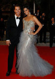 Matthew McConaughey looked dapper alongside Camila Alves as they posed on the red carpet in May 2012 at the Cannes premiere of his movie Mud.
