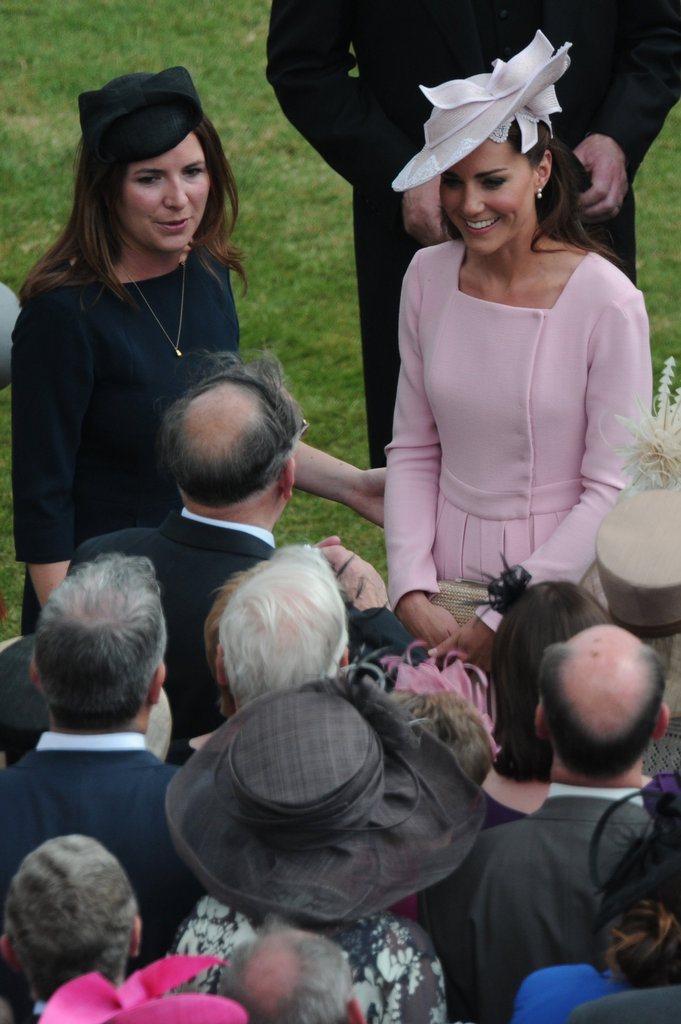 Kate Middleton smiled as she met with guests.