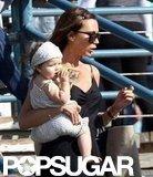 Victoria Beckham carried daughter Harper Beckham.