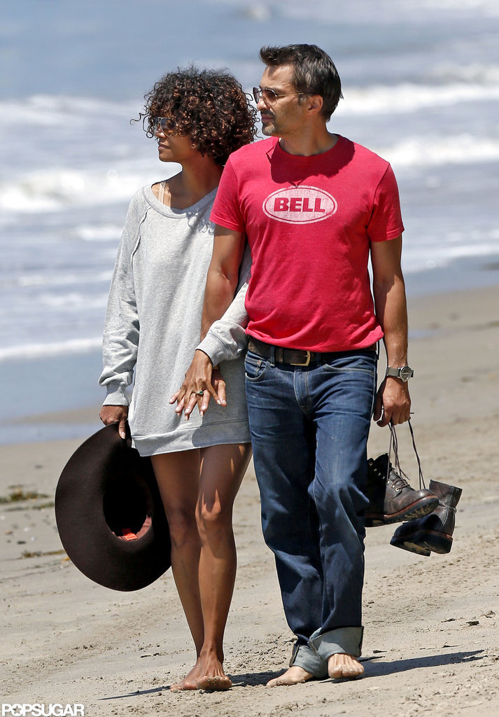 Halle Berry and Olivier Martinez enjoyed a romantic walk on the beach together.