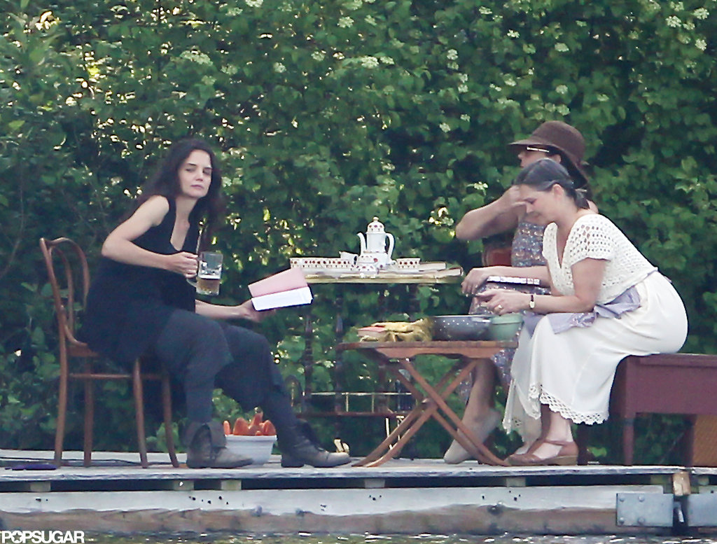 Katie Holmes held a beer on set while shooting a scene.