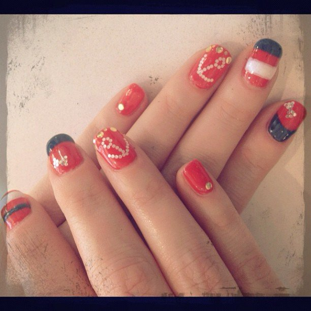 Zooey Deschanel shared a photo of her patriotic nail paint job.  Source: Instagram User zooeydeschanel