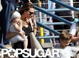 Victoria Beckham carried daughter Harper Beckham with son Romeo Beckham.