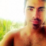 Joe Jonas was shirtless and scruffy in Thailand.  Source: Instagram user adamjosephj