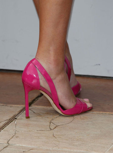 A close-up of Reese's bright pink Manolo Blahnik sandals.