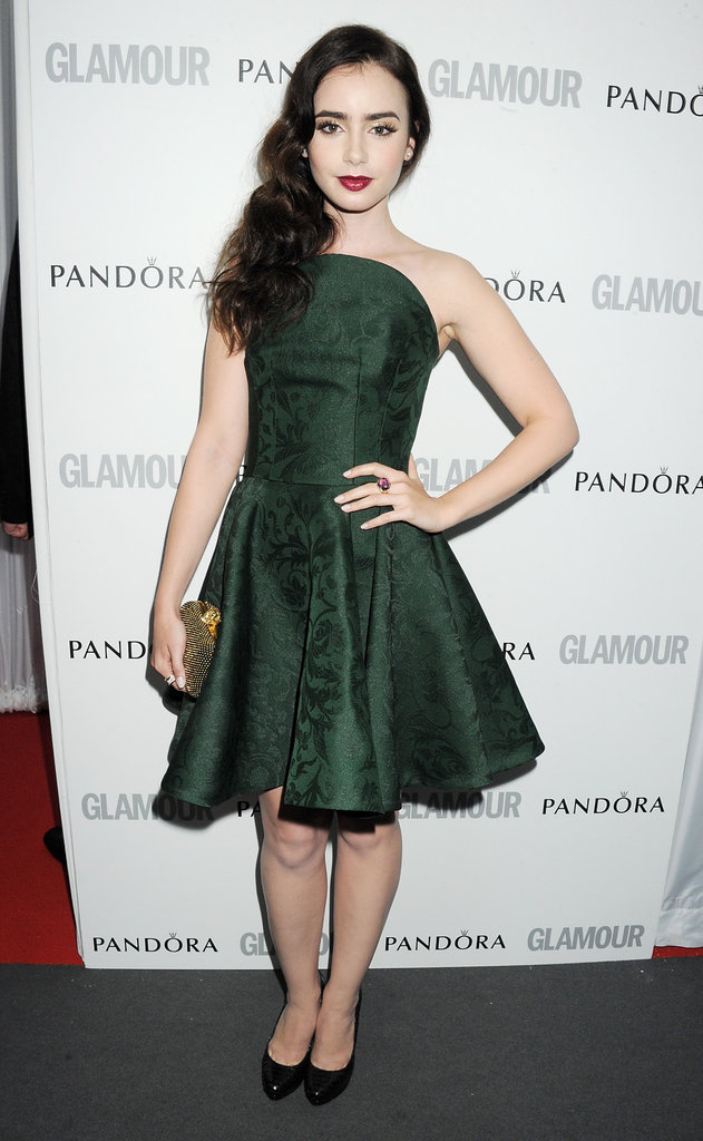 Lily Collins wore a forest-green Alexander McQueen strapless cocktail frock with black pumps and a gold clutch.