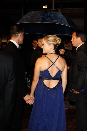 Reese showed off her toned back in a crisscross-style Atelier Versace gown.
