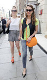 Jessica Alba wore studded pointy-toe flats with a lime green tee, black vest and Current/Elliott star-print jeans — we love how she added an extra dose of bold color with her orange crossbody bag.