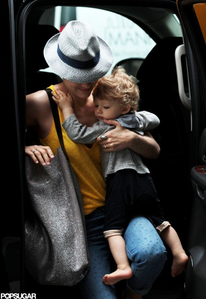Marion Cotillard held tight to baby Marcel as she climbed out of the car in NYC.
