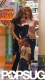 Angelina Jolie carried Zahara Jolie-Pitt on a toy shopping outing in LA with Maddox Jolie-Pitt in July 2005.
