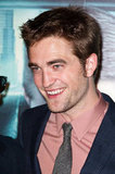 Robert Pattinson flashed a smile at the Cosmopolis premiere in Paris.