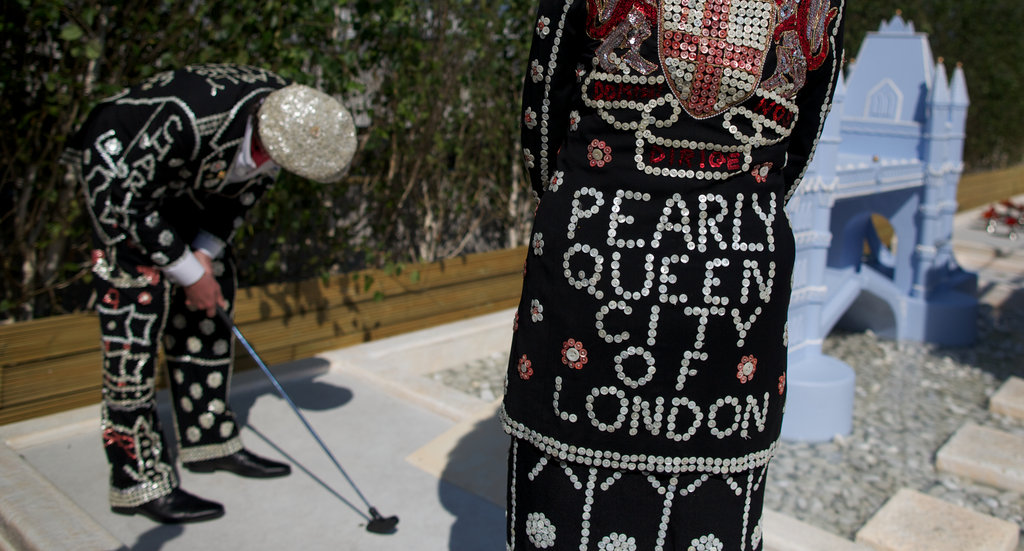 The Royal Family of the Pearly King and Queen of the City of London played mini golf.