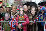 People in Norway wore royal family masks for the Diamond Jubilee visit from Prince Charles and Camilla.