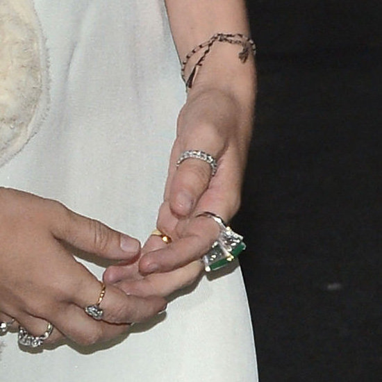 Ashley didn't leave her left hand bare. She wore a large cocktail ring with a green stone, as well as a diamond band on her thumb and a string bracelet. Sport this green agate ring from Macy's ($300) with this Endless pave band ($70) and Reiss thread bracelet ($55) to mimic Ashley's left hand.