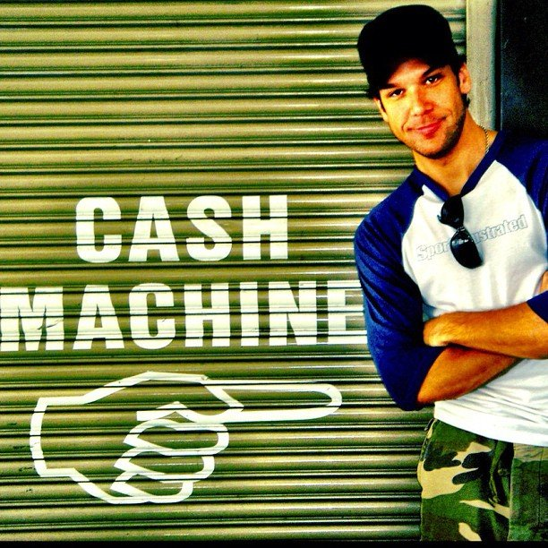 Dane Cook couldn't resist the opportunity to snap a photo with this cash machine sign.  Source: Instagram user danecook