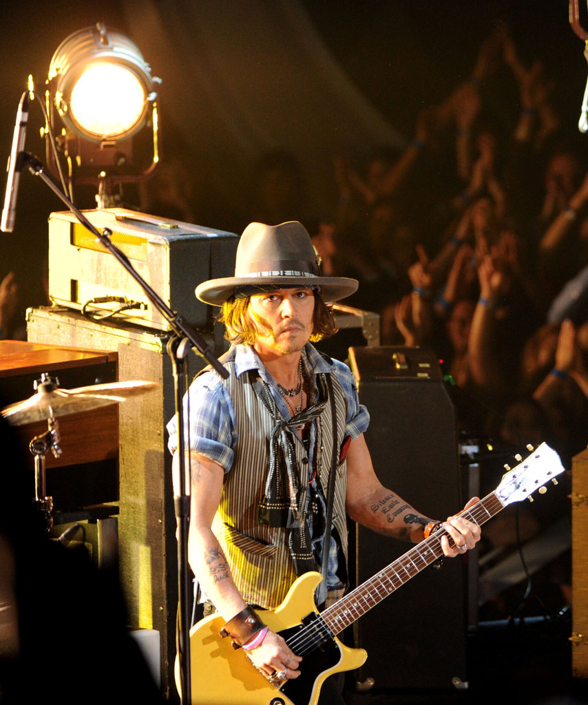 Johnny Depp performed on stage at the MTV Movie Awards.