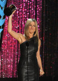 Jennifer Aniston proudly held her Popcorn as she accepted her award.
