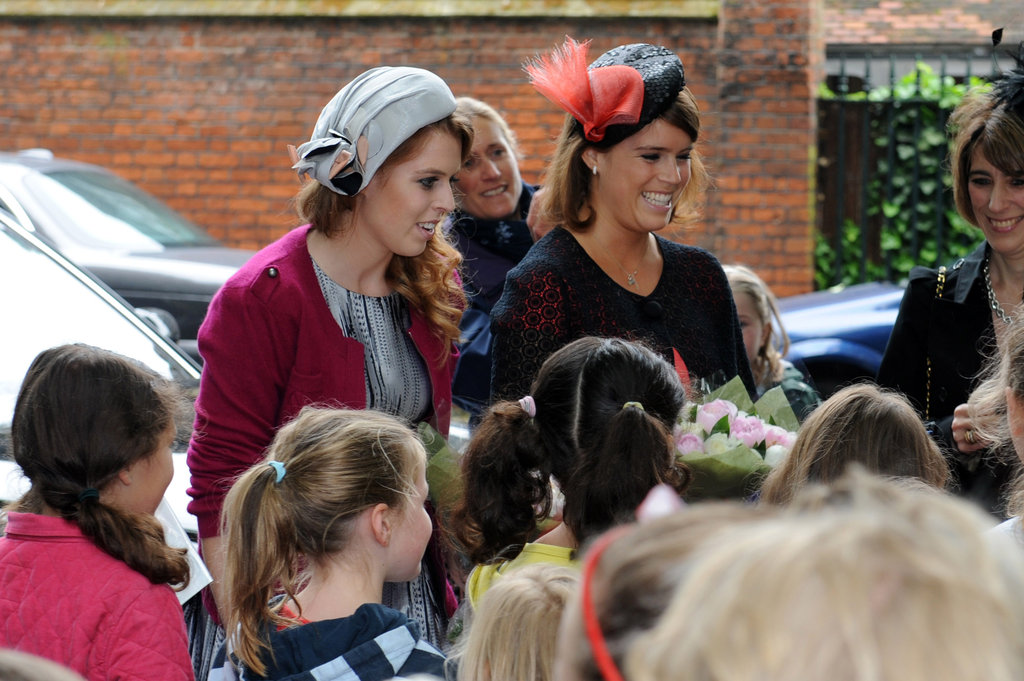 Princesses Eugenie and Beatrice talked with children at the street party.