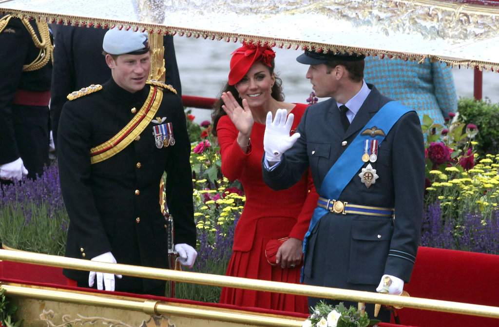 Prince Harry, Kate Middleton, and Prince William waved aboard the royal barge, Spirit of Chartwell.