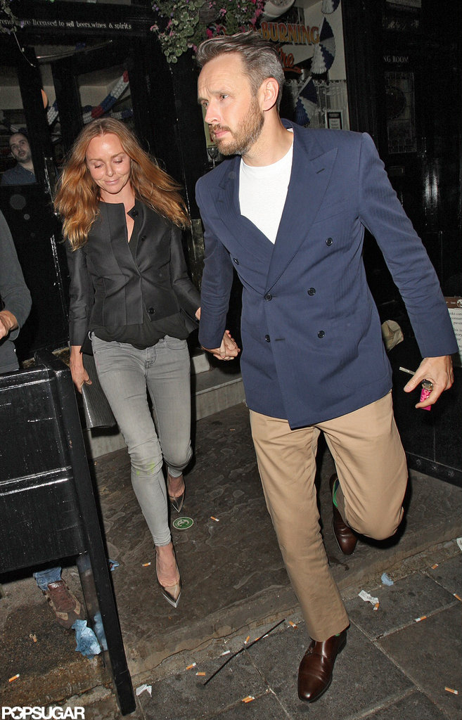 Stella McCartney and her husband Alasdhair Willis joined David Beckham at a pub in London.