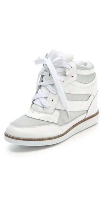 Get in on the wedge sneaker trend with this cool optic white pair.  Jeffrey Campbell Gio Hidden Wedge Sneakers ($205)