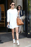 We love Eva Longoria's modern play on this LWD; just add open-toe ankle boots and a luxe-feeling tote to yours to do the same.