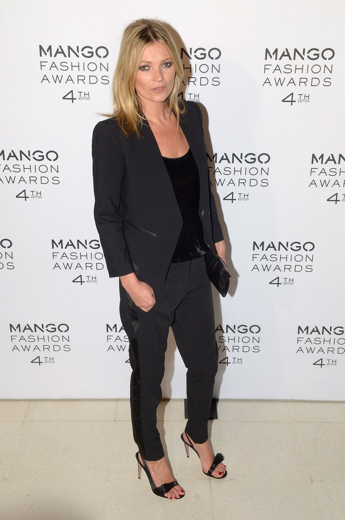 Kate Moss suited up in menswear-inspired separates for an effortlessly polished evening look.